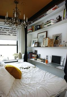 Small Bedroom Design: still maintaining elegance; shelves, bed a seat for work space, love the tack idea, shelf a desk, thin, small shelf in front of window, chandelier, painted ceiling, white