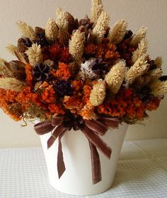 Charming Fall arrangement - dried flowers in fall colors in white pot with brown velvet bow!