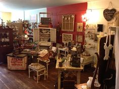 The Farmhouse Sisters booth at Trestle Side Antiques in Ringgold, GA offers primitive, vintage, and shabby chic wares along with custom wedding designs.
