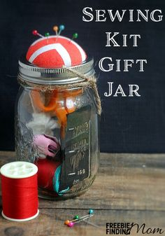 Sewing Kit Gift Jar - This DIY gift in a jar is perfect for any crafty fashionista or someone learning to sew. Customize her Mason jar with fun colors of thread, a new thimble, and other sewing essentials that are sure to inspire her.