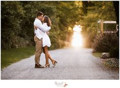 Summer engagement photo inspiration!  Beautiful, timeless sunset engagement portrait on a winding gravel road in the woods photographed by Massart Photography, a RI newborn, family and wedding photographer.