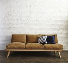 You probably already know about Steven Alan's new enterprise, a home shop in Tribeca. Our favorite offering from this low-key fashion designer? A series of custom sofas and side tables by Jason Pickens.