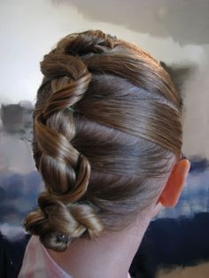http://babesinhairland.com/hairstyles/5-ponytails-a-snake-updo/