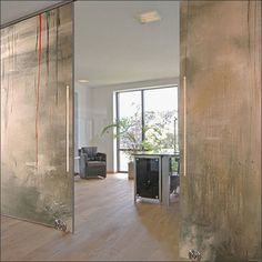 Taramino, A contemporary sliding door design which includes barn door hardware. A fine art piece by Sargam Griffin