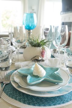 Layer up pretty coastal dishes for a tablescape your guests will love!