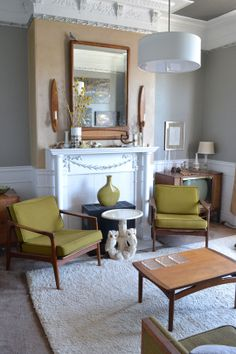 The chairs in this room from Apartment Therapy reminded me of some chairs I have in the basement.  They're not as loungy as these, but have similar mid-century wood frames and feel to them.  I'm going to recover them and see what happens.