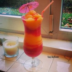 FROZEN STRAWBERRY MANGO COCKTAIL ***Red Layer*** 1 1/2oz. (45ml) Rum 2 Cups Frozen Strawberries 1 oz. (30ml) Simple Syrup Splash of Grenadine (for color) Cup of Ice  ***Yellow Layer*** 1 1/2oz. (45ml) Rum 2 Cups Frozen Mango Chunks 1 oz. (30ml) Simple Syrup 1 1/2oz. (45ml) Peach Schnapps Cup of Ice