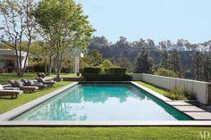 Brazilian-granite coping borders the pool at Ellen DeGeneres and Portia de Ross' house    archdigest.com