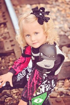 Girl dirt bike session. So cute!!  You can tell she hasn't actually ridden yet..