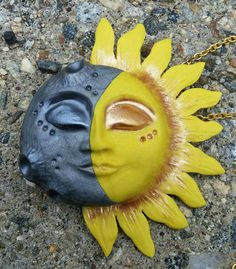 Check out this item in my Etsy shop https://www.etsy.com/listing/287741869/sun-moon-polymer-clay-pendant-necklace