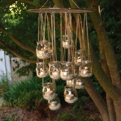 Re-put posing baby food jars as a candle chandelier for the garden
