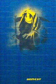"""BANSKY   """"The easy humour that makes his work superficially likable removes from it any hope of being mad or poetic. He chooses grimly potent images, yet never has the Grim Reaper been less grim than on a wall in Shoreditch, where he gives Death a yellow smiley face."""" -Jonathan Jones on Banksy's """"The Grin Reaper"""""""