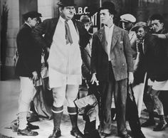 You're Darn Tootin', Oliver Hardy loses his pants, while Stan Laurel looks on, Laurel and Hardy http://laurel-and-hardy.net/youre-darn-tootin-1928-starring-stan-laurel-oliver-hardy/