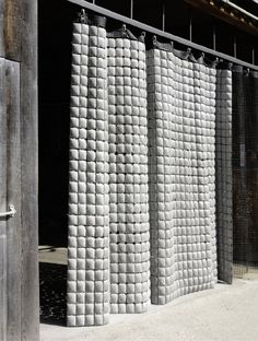 Concrete tiles curtain