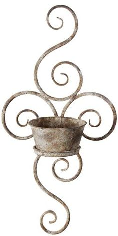 Esschert Design USA Aged Metal Wall Planter: The aged metal finish of this wall planter is a perfect addition to your outside decor. The beautiful scrolled design will look great on any wall.