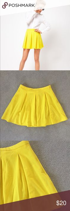 ASOS Pleated yellow mini skirt size 8 This yellow Pleated mini skirt from ASOS is so cute for the spring and summer season! It's a size 8, and in good condition with minor wear-very light piling. It has a zipper closure. From top to bottom down the middle it measures 16 inches. When laid flat across the top measures 14 inches #skirt #asos #spring #summer #yellow #pleated ASOS Skirts Mini