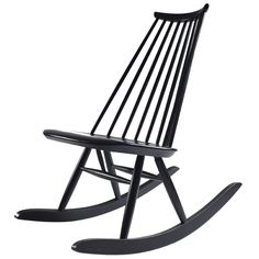 Mademoiselle rocking chair designed by Ilmari Tapiovaara for Ask  Finland  1959  Mademoiselle rocking chair designed by Ilmari Tapiovaara in 1956. Late edition from Asko of the Seventies