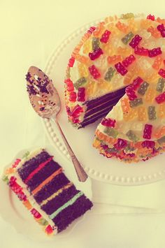 Chocolate layer cake with rainbow frosting and gummy bears! No recipe, just an idea :)