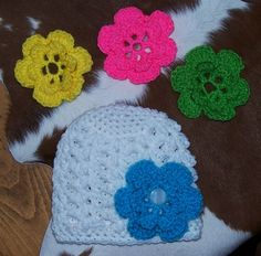 Shell beanie with interchangeable button on flowers  For purchase info:  Crochethooker2450@yahoo.com