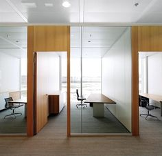 TIX in offices in Europe - solid wood desks with Herman Miller Eames chairs