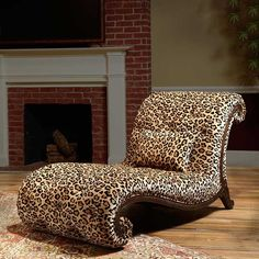 Victoria's Manor Chaise is part of our <i>Designer Collection</i><br><br />This makes a bold statement in any room. It features long, sensuous curves and daring leopard print upholstery. The button tufted back and seat gives this chaise a timeless appeal.  <br /> [$2,199.95]