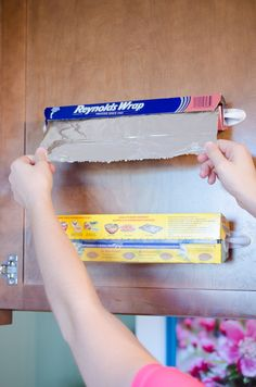make rolls of foil and plastic wrap easily accessible on the inside of your cabinet.