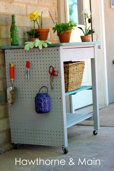 Kitchen Cart turned Gardening Station.  Check out that added storage on the side.  What a great idea!