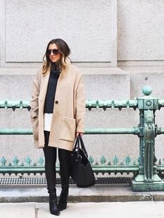 A clean, camel-colored wool coat punctuates @dallasshaw's refined ensemble.