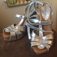 Gianni bini wedges Moderate use.  Silver metallic Gianni Bini Shoes Wedges