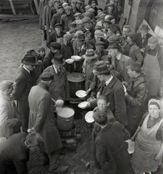 1944 - 1945. People in line at a soup kitchen at the Stenen Hoofd. During the Honger Winter in Amsterdam there's was no fuel, no petrol, no electricity. One loaf of bread and a kilo of potatoes a week per person. The farmers, still having food for sale, don't accept money. They want jewelry, gold, silver for their potatoes. More than 20,000 people lost their lives in the western part of the Netherlands during the winter of 1944-1945. #amsterdam #worldwar2 #hongerwinter