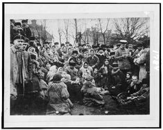 Library of Congress: Crowd of refugees(?)--, possibly Jewish, and three officials outdoors, Russia, 1912