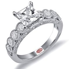 Designer Engagement Rings from DemarcoJewelry.com  	 	 	Available in White or Yellow Gold 18KT and Platinum. 0.70 RD 	 	Capture her grace and endless beauty with this confident yet elegant design. 	We have also incorporated a unique pink diamond with every single one of 	our rings, symbolizing that hidden, unspoken emotion and feeling one 	carries in their heart about their significant other. 	 	This is not just another ring, this is a heirloom piece of jewelry. 	 	Demarco Bridal Engagement…