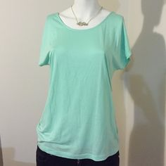 Mint shirt. Mint colored short sleeve top. This item has an upper back open concept with black strap crisscross accent. Forever 21 Tops Tees - Short Sleeve