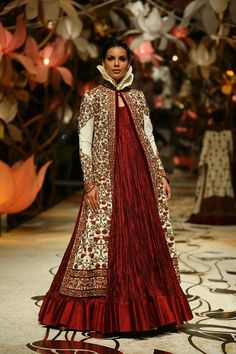 Rohit Bal at India Bridal Week 2013 - Red gown teamed with a long coat with a high frilled collar and kashmiri embroidery