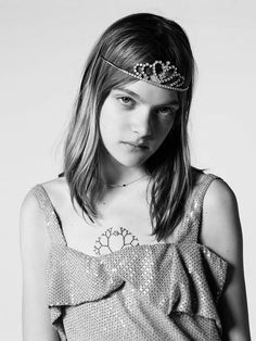 A sequin dress is worn with a thin necklace and tiara for Saint Laurent Spring/Summer 2016
