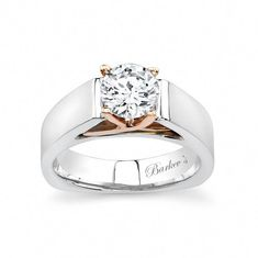 Clean strong contemporary styling with a flair for the unique this two-tone solitaire ring has it all. A cathedral shank rises up just under the round center diamond with fancy rose gold criss-crossing prongs. A squared shank adorns the bottom of the ri Solitaire Ring Designs, Wedding Rings Solitaire, Wedding Bands, Bridal Rings, Deco Engagement Ring, Vintage Engagement Rings, Emerald Jewelry, Diamond Jewelry, Gold Jewelry
