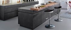 Topping the entire worktop surface with an earthy material like butcher's block in a German kitchen brings it back down to the level of us mere mortals. Kitchen Cabinets Brands, Kitchen Countertops, Black Kitchens, Cool Kitchens, Kitchen Island Table, German Kitchen, Cabinet Fronts, Best Kitchen Designs, Kitchen Ideas