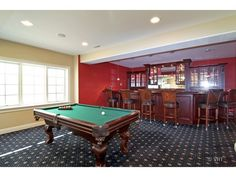 Lower Level Rec Room, full bar with beverage refrigerator, dishwasher, microwave and pool/ping pong table.