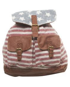 Represent the red, white and blue with this super cute Americana backpack featuring a faded American flag print all over its soft material, along with faux leather trim all over, including its adjustable straps, pocket flaps, buckle strap and adjustable drawcords around the bag entrance. The exterior front has two front pockets that close with a snap button detail and a top flap that folds over with a faux leather strap that dangles off and snaps into place at the magnetic button.