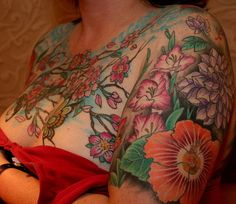 Chest and half sleeve tattoo.