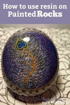 Learn how to make beautiful and glossy rocks using resin. These tips will help you to create amazing painted rocks! #resin #paintedrocks #glossy #howtopaintrocks #rockpaintingideas #stonepainting #rockpainting101