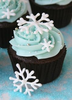 Chocolate Cupcakes With Blue Vanilla Frosting And Hardened Icing Snowflakes