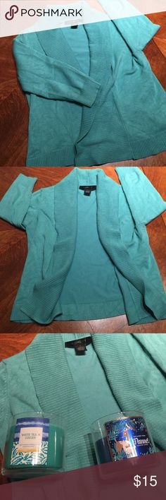 "Sea foam teal cropped cardigan sweater Extremely soft cardigan sweater. Size small, fits upto medium. Purchased at Nordstrom, worn a few times. Wrinkled from being in the ""photograph for poshmark one day"" box... whoops! 74% rayon, 28% polyester. Quality cropped cardigan. 3/4 sleeves. No buttons no pockets. Candles for color comparison. Bright seafoam teal color. Sweaters Cardigans"