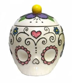 Ceramic Skull Cookie Jars Sugar Skulls have become very popular,  these are more delicate with their patterns and not as bold as most decorated sugar skulls.