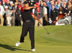 Tiger Woods pumps his fist in celebration after making a birdie on No. 18 to win the Chevron World Challenge on Sunday.