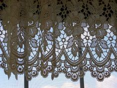 Dutch Lace Curtains....this is a picture of one's hanging in my brother's home.