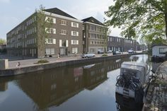 Gouda Cheese Warehouse: two architectonical interventions will make it possible to transform the old warehouse into a residential building full of light, air, and space. By mei architects and planners.