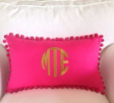 Monogrammed Pique Pom Pom Pillow on Etsy, $48.00 so cute but I am skeptical of pompoms!  :)