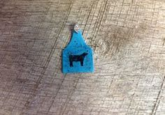 Blue ear tag pendant with blue sparkles and black steer silhouette. Comes with rhinestone pinch bail. Repin to be entered to win one of four $50 gift certificates during our Five Year Anniversary Celebration in July 2014.