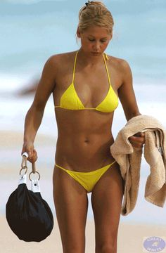 The hottest pictures of Anna Kournikova in a bikini, swimsuit, or other swimwear. You probably know Anna Kournikova as being maybe the hottest tennis player ever. She really raised the bar for all … The Bikini, Sexy Bikini, Bikini Girls, Bikini Swimsuit, Yellow Bikini, Bikini Beach, Anna Kournikova, Seductive Photos, Pictures Of Anna